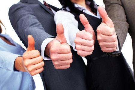 Foto de Hands of happy business people with thumbs. - Imagen libre de derechos