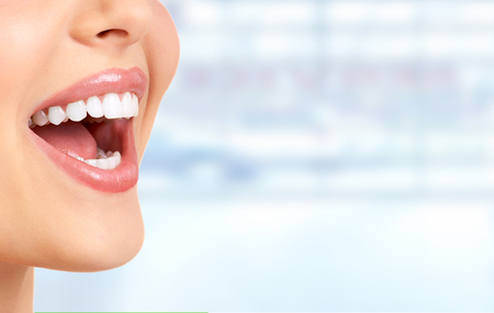 Photo pour Laughing woman mouth with great teeth over blue background. - image libre de droit