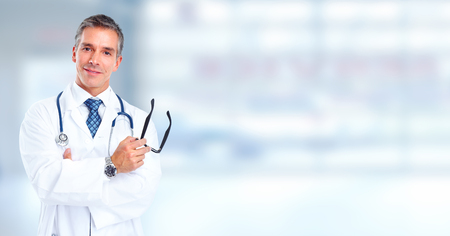 Photo for Friendly Family doctor man over hospital banner background. - Royalty Free Image