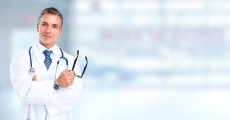 Photo pour Friendly Family doctor man over hospital banner background. - image libre de droit