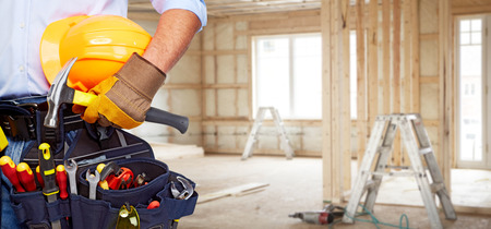 Photo for Builder handyman with construction tools. House renovation background. - Royalty Free Image