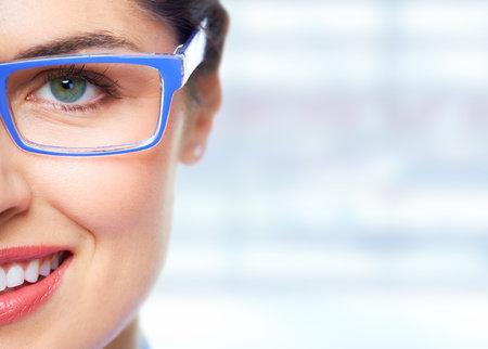 Photo pour Beautiful Woman eye with glasses over blue banner background. - image libre de droit