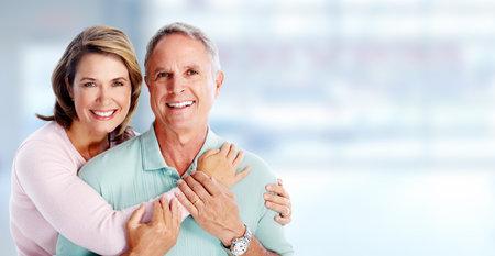 Photo pour Happy senior couple portrait over blue background. - image libre de droit