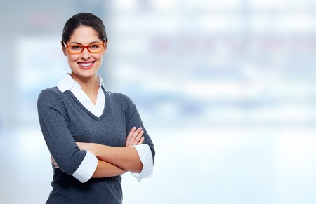 Photo for Beautiful smiling business womanover blue office background - Royalty Free Image