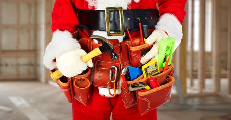 Photo pour Santa Worker with a tool belt construction background. - image libre de droit