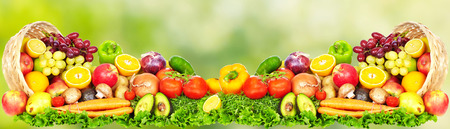 Photo for Fruits and vegetables over green background. Healthy diet. - Royalty Free Image