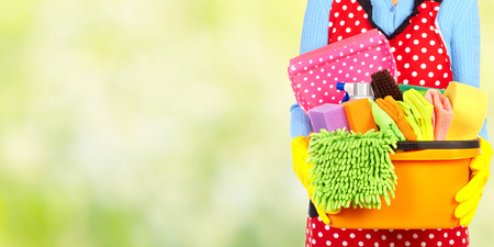 Photo pour Maid hands with cleaning tools. House cleaning service concept. - image libre de droit