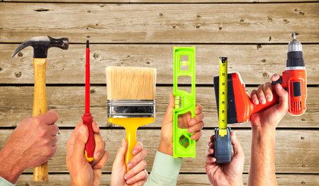 Photo pour Hands of handyman with tools. House renovation and construction. - image libre de droit