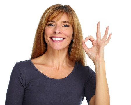 Foto de Beautiful happy woman isolated over white background. - Imagen libre de derechos