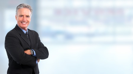 Photo for Smiling mature  businessman over blue background - Royalty Free Image