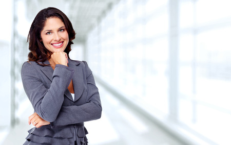 Photo pour Beautiful young business woman over blue office background. - image libre de droit