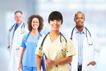 Photo pour Group of hospital doctors over Health care clinic background. - image libre de droit