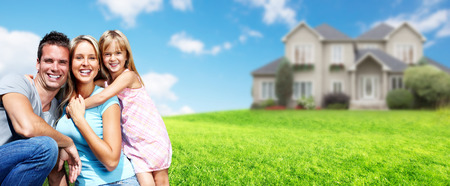 Photo pour Happy family with children near new house. Construction and real estate concept. - image libre de droit