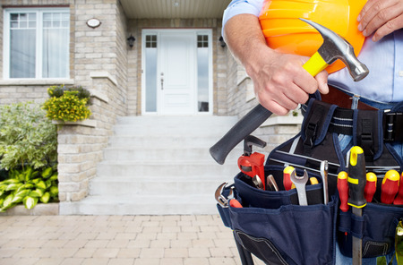 Photo for Handyman with a tool belt. House renovation service. - Royalty Free Image