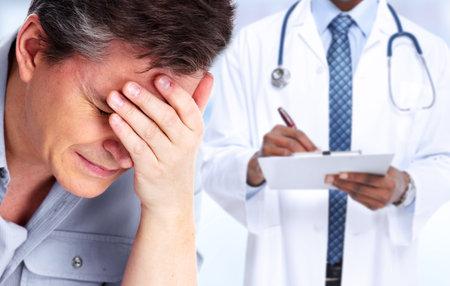 Photo pour Tired man with headache migraine. Stress and health. - image libre de droit