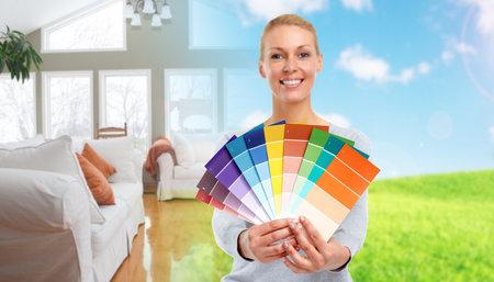Photo pour Woman with painting colors. House renovation background. - image libre de droit