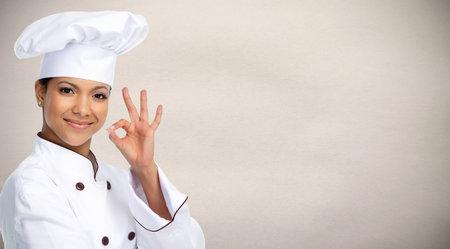 Foto de Smiling Asian chef woman. Food and diet concept. - Imagen libre de derechos