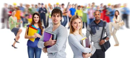 Foto de Group of young smiling students. Education concept background. - Imagen libre de derechos
