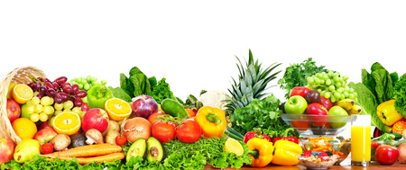 Foto de Fresh fruits and vegetables over white background. - Imagen libre de derechos