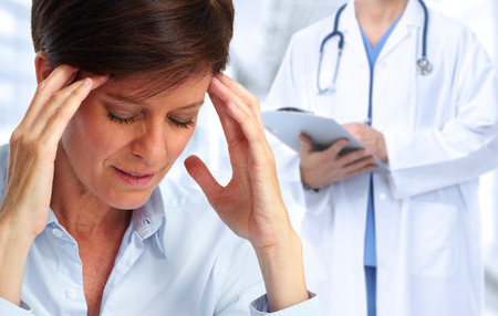 Foto de Tired business woman with headache migraine. Stress and health. - Imagen libre de derechos