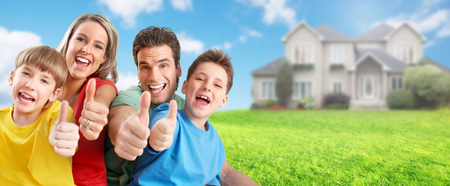 Photo pour Happy family with children near new house. Construction and real estate concept. - image libre de droit
