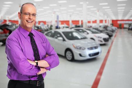 Photo pour Car dealer man. Auto dealership and rental concept background. - image libre de droit
