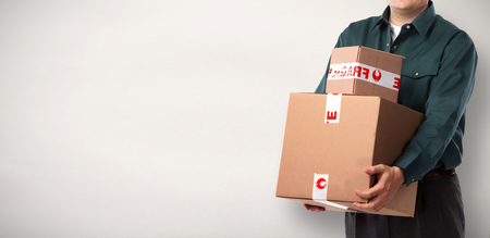 Photo for Delivery postman with a box over blue background. - Royalty Free Image