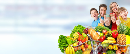 Foto für Happy family  with grocery shopping cart over blue abstract background. - Lizenzfreies Bild
