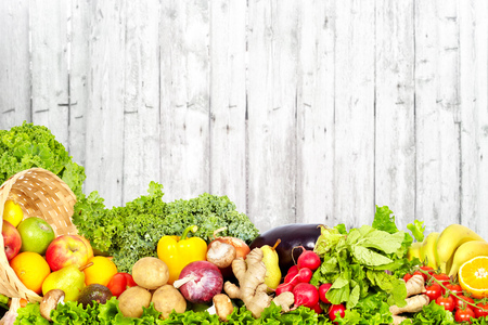 Photo for Vegetables and fruits on vintage wooden wall background. - Royalty Free Image