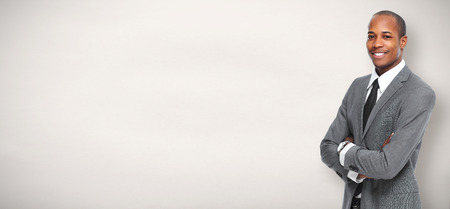 Foto per African American Business man over gray background. - Immagine Royalty Free