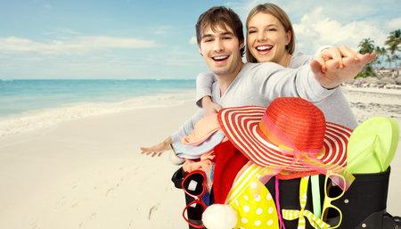 Photo pour Suitcase ready for vacation with bikini and sunglasses. - image libre de droit
