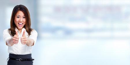 Photo pour Happy chinese business woman over blue background. - image libre de droit