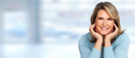 Photo pour Beautiful senior woman portrait over blue background. - image libre de droit