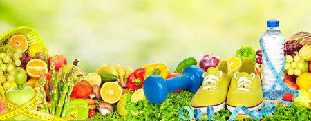 Photo pour Fresh fruits and vegetables over green background. - image libre de droit