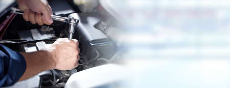 Photo pour Hands of car mechanic with wrench in auto repair service. - image libre de droit