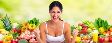 Foto für Beautiful young woman over fruits and vegetables diet background. - Lizenzfreies Bild