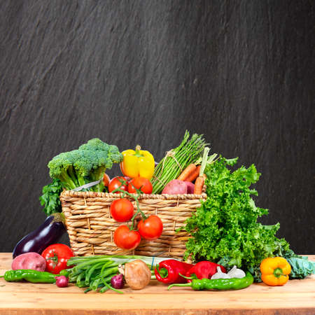Photo for Organic vegetables variety on the table in kitchen - Royalty Free Image