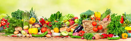 Foto de Organic vegetables and fruits variety on the table in kitchen - Imagen libre de derechos
