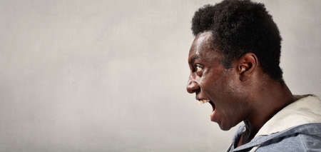Photo pour Angry fury african american man portrait. People face expressions. - image libre de droit