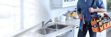 Photo pour Professional plumber working renovation in kitchen home. - image libre de droit