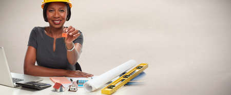 Photo for African-American architect woman with key. - Royalty Free Image