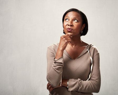 Photo pour Thinking african woman - image libre de droit