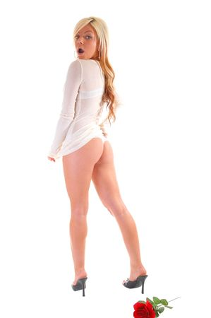 A lovely young girl in an white sweater and thong, shooing her nice butt is surprised that somebody is seeing her so.