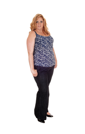 Photo pour A heavy woman standing in black dress pants and blouse with blond long hair isolated for white background  - image libre de droit