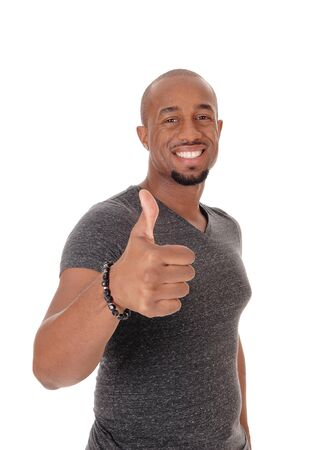 Photo pour A smiling African American man standing in a sweater pointing with his thump to the other person, isolated for white background - image libre de droit