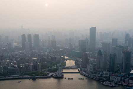 Photo pour modern city in a pollution at sunset (Shanghai, China) - image libre de droit