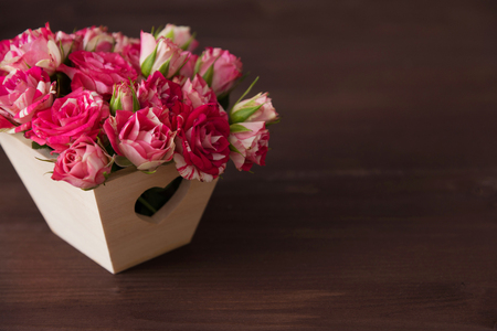 beautiful romantic small bouquet of pink roses in wood box decorated heart