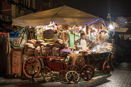 POLAND, KRAKOW - JANUARY 01, 2015: Festive New Year Fair in night Krakow on the Main Market Square in the historic center of the old town.