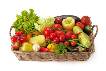 Photo for Fresh and ripe vegetables arranged in a basket isolated on white. Healthy organic food. - Royalty Free Image