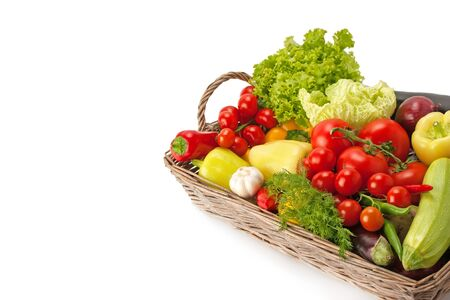 Photo for Fresh and ripe vegetables arranged in a basket isolated on white. Healthy vegan food. Photo with free space for text. - Royalty Free Image